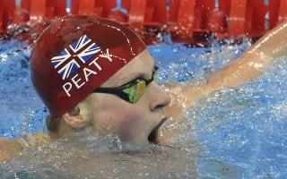 Adam Peaty breaks own world record in breaststroke heats
