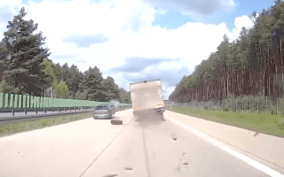 Car crashes into runaway truck wheel on highway