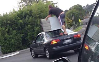 New Zealanders caught shifting fridge on top of car