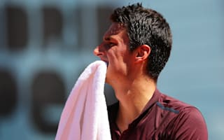 Tomic blames illness after retiring eight minutes into match
