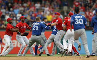 Rangers' Odor suspended eight games for punching Bautista