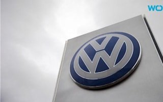 Volkswagen profits tumble as emissions scandal takes toll