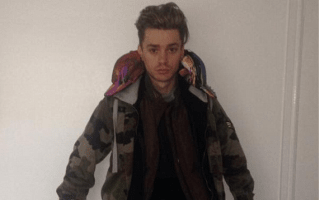 Boyband singer collapses in 12 layers of clothes worn to avoid airline baggage fees
