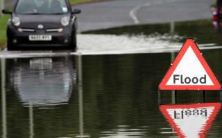 Police warn of flood conmen preying on stricken vehicles