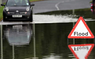Police warn of flood conmen preying on stricken vehicles