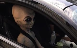 Police officer gets a shock as he pulls over a car with an alien doll sat in the passenger seat