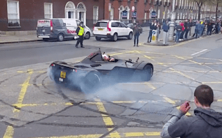Racing driver performs donuts to start Gumball Rally