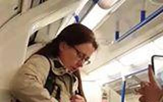 London Underground commuters joined by nosy pigeon