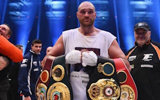 Fury voluntarily vacates titles