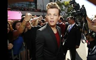 'No plans to charge' Louis Tomlinson over photographer incident