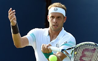 Muller shocks Ferrer in Rosmalen to book Karlovic clash