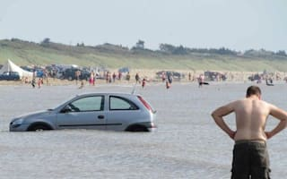 Young motorist parks car on beach and returns to find it swimming