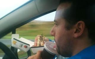 Police hunt driver filmed 'asleep' at the wheel and motorist snapped scoffing meal