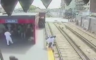 Child narrowly avoids death after mum lets her walk on train tracks
