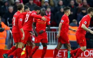 Henderson urges focus in Liverpool's title tilt