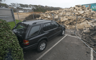Car gets blocked in by rubble after building work begins