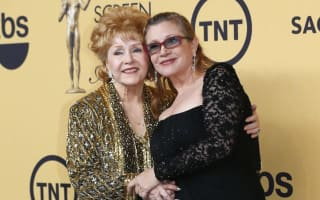 Fans pay respects to Carrie Fisher and mother Debbie Reynolds at joint memorial