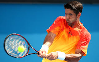 Verdasco crashes out, Lopez through