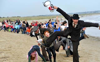 Tourists descend on Dorset beach for 'silliest walk' competition