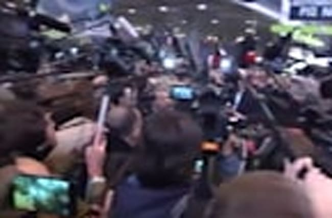 Media scrum follows Le Pen's farm show visit