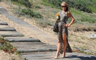 Paris Hilton wears Louboutin heels to the beach in Uruguay