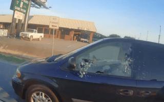 Road raging biker throws rock through minivan window