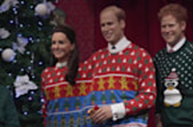 Kate and William waxworks dressed in Christmas jumpers