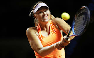 Fired-up Sharapova fights back to reach Madrid second round