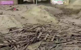 Peru flooding: Woman crawls from mudslide