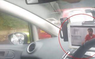 Woman caught watching TV on iPad at the wheel
