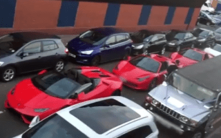 Fleet of supercars left to block road while drivers attend a wedding