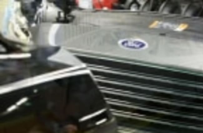 Ford's profit skids 35 percent