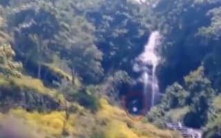 Is that 'Bigfoot' walking through waterfall in Indonesia?