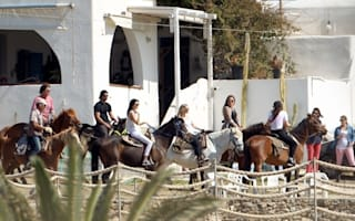 Giddy up! The Kardashian Klan go horse riding on holiday in Greece