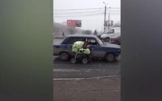 Motorists caught pulling a pram alongside a car on busy road