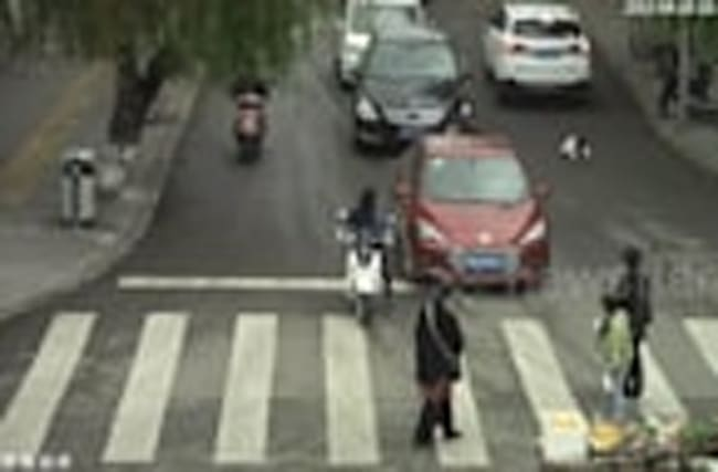 Toddler miraculously avoids being run over by cars by lying down on road