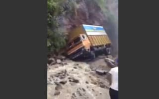 Truck driver braves 'worst road in the world' (video)