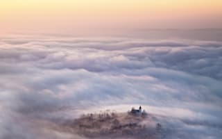 Where is this sleepy  village lost in a sea of clouds?