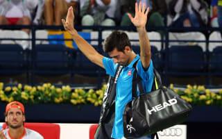 Djokovic retires from Lopez clash with eye problem
