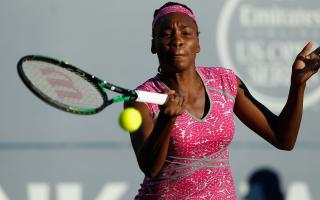Venus wins through, Wozniacki hurt