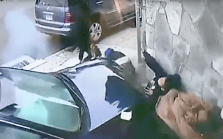 Terrifying moment woman dives in front of child as a car crushes them against a wall