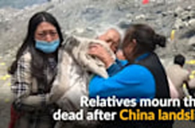 China villagers mourn dead after landslide