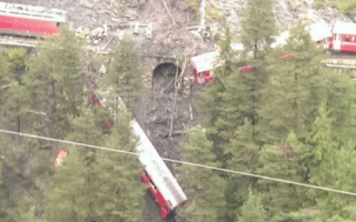 Train derails in Swiss Alps: Carriage hanging over ravine