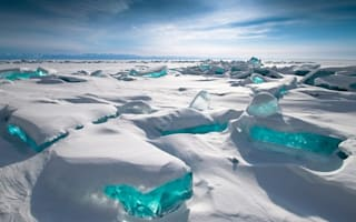 Incredible pic shows 50ft ice 'gems' on frozen lake in Siberia