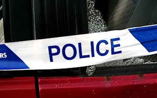 Pedestrian dies after being hit by police car