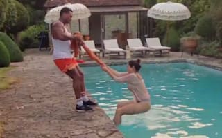 Kelly Brook tries to climb out of holiday pool using a towel (video)