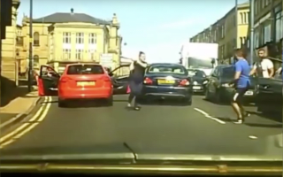 Woman helps partner in road rage incident with a bat