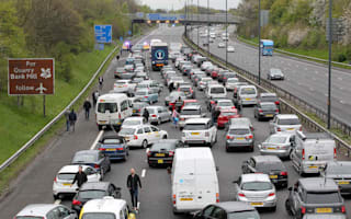 Dozens of holidaymakers abandon cars on blocked M56