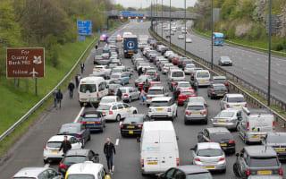 Dozens of holidaymakers abandon cars on blocked M56