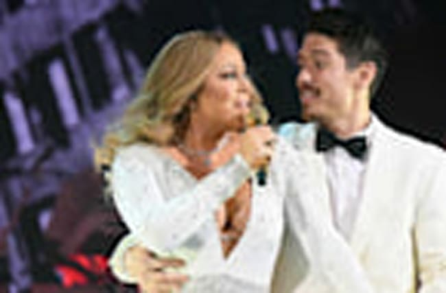 Mariah Carey Lights Up Empire State Building Holiday Lights, Gets Close to Bryan Tanaka on Stage
